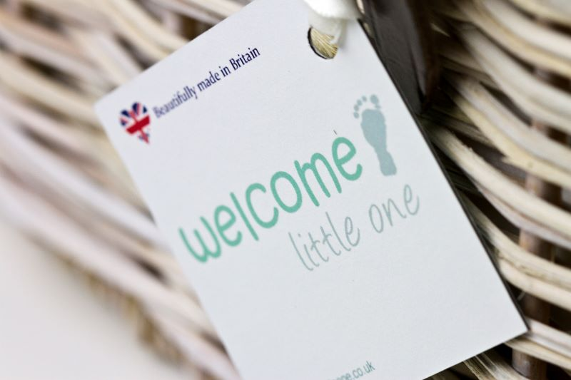 Welcome Little One Hampers's logo